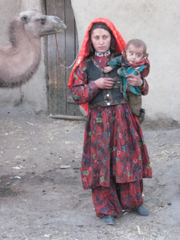 afghanistan woman and camel