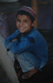 smiling afghan boy